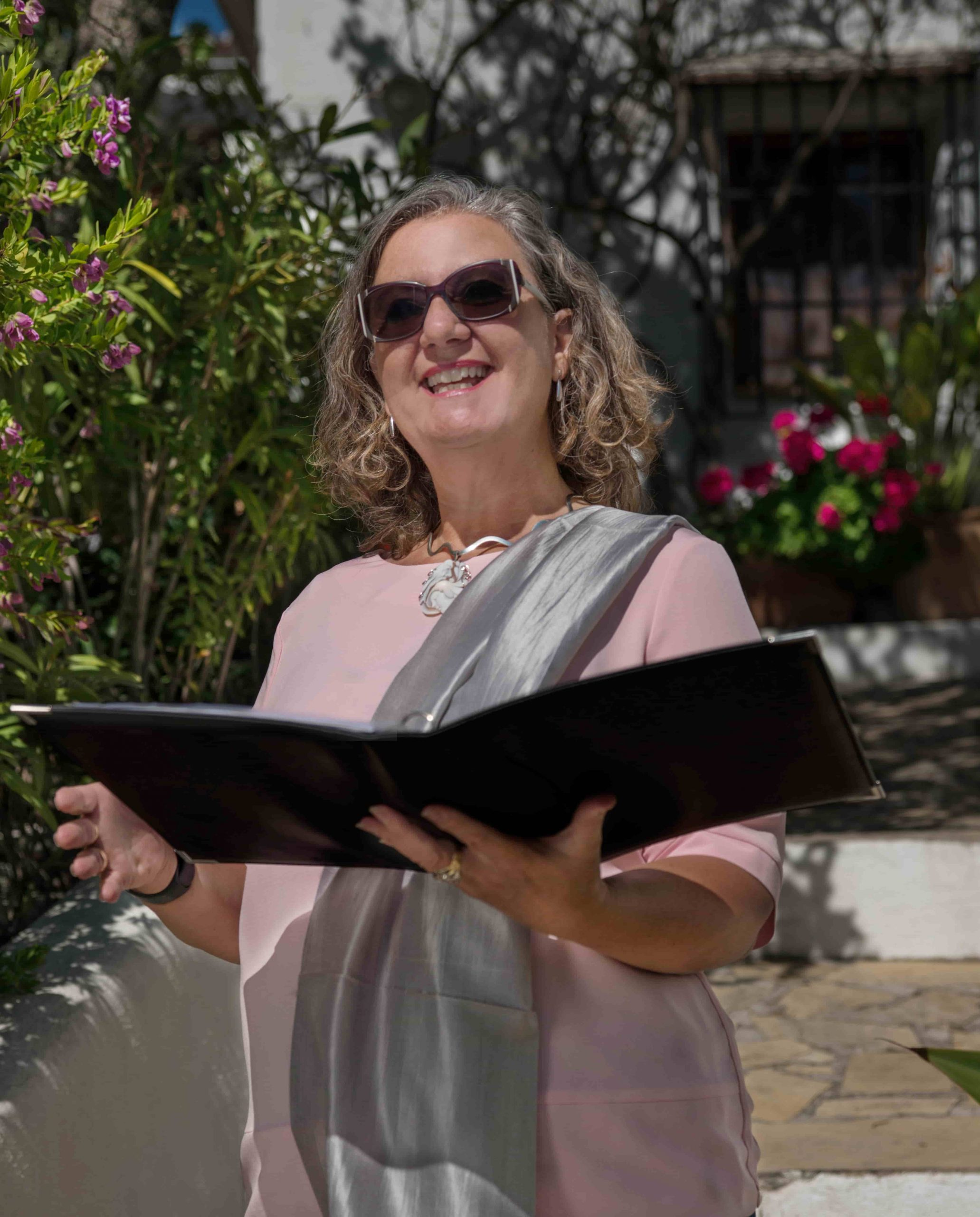 Wendy-Sherwood-Celebrant-Reading-From-Black-Folder