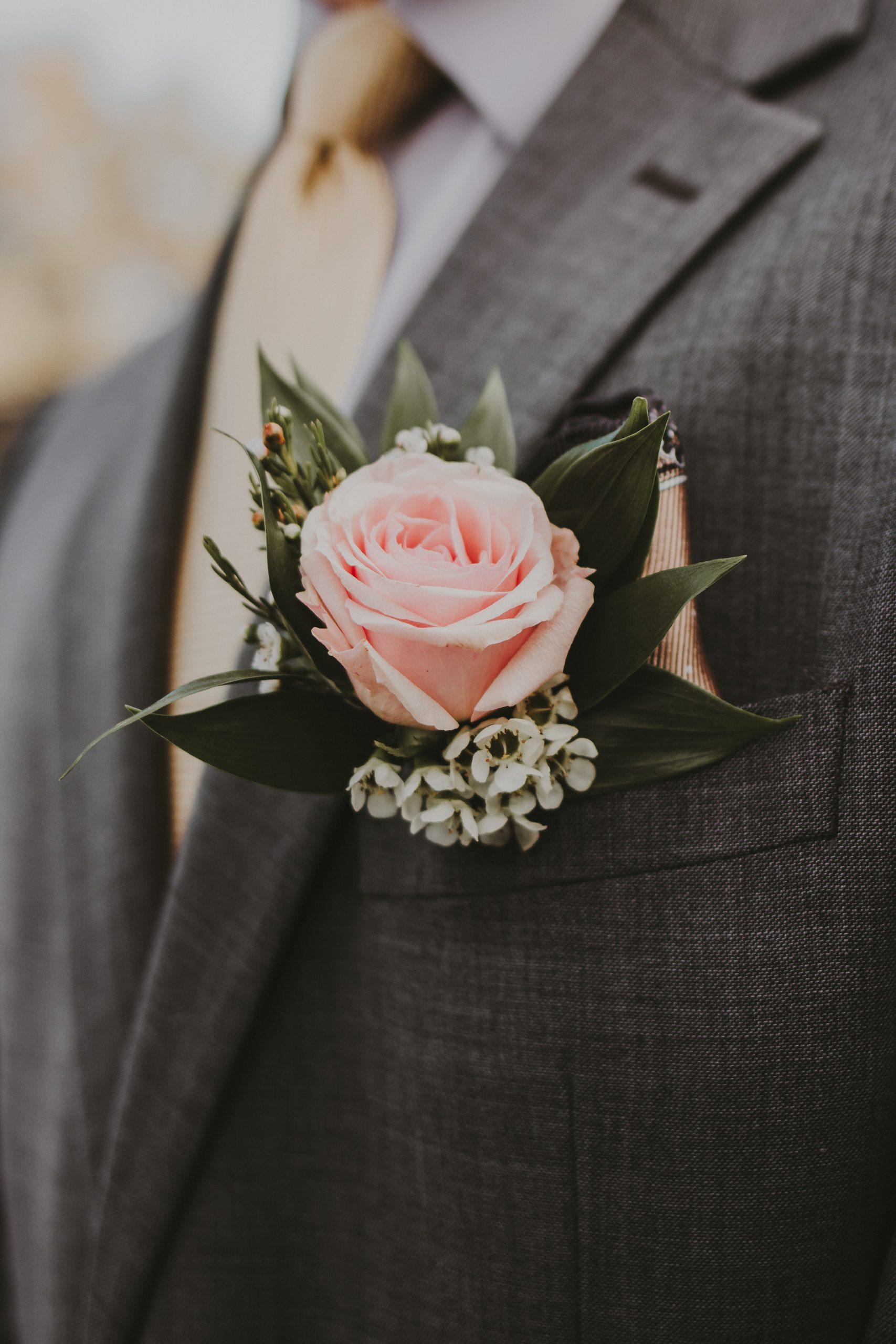 Grey-suit-groom-pink-flower